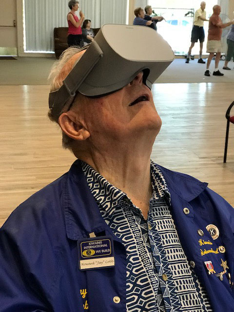 Jay Cobb tests a virtual reality headset at a library outreach program with the Kiwanis Club of Oakmont on July 18, 2019. Photo by Bridget Hayes
