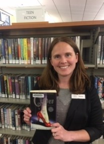 "woman holding book ""Cinder"" by Marissa Meyer"