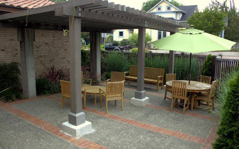 Millie Howie Patio with plants and outdoor furniture