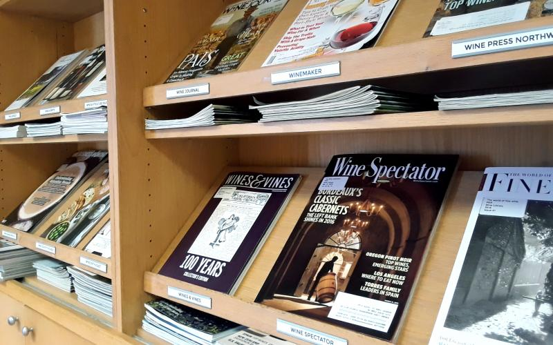 Angled image of the periodical shelves showing about 10 magazine covers