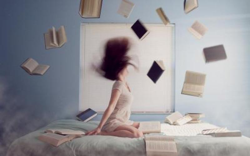 Teen with many books