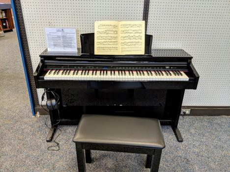 The Williams Overture 2 88-key console digital piano photo